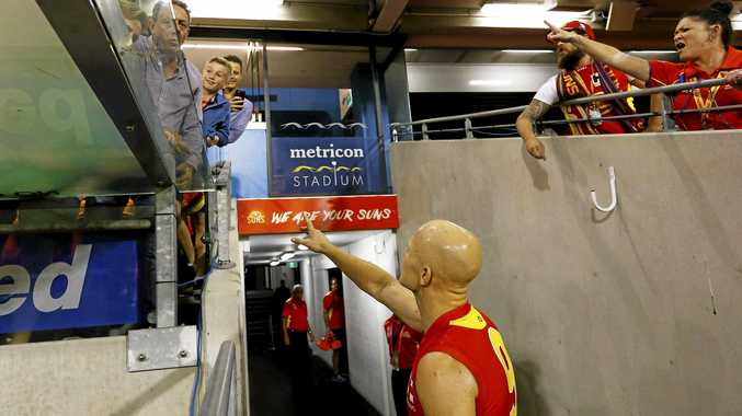 Not on ... Gary Ablett reacts to a fan yelling abuse at Metricon Stadium. Photo: AAP Image/Jason O'Brien.