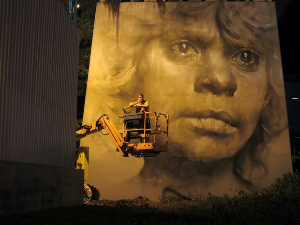 Brisbane artist Guido van Helton with his Pillar Project mural.