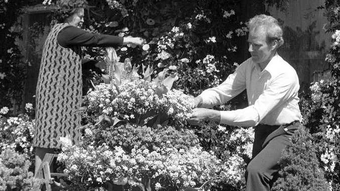 Historic: Ben and Mavis Mundey were winners of the garden competion several times, prepare their garden for the Carnival of Flowers garden competition in 1979. Negative reference: X402. Photo: The Chronicle