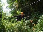 Reporter Rae Wilson doing a superman zip-line across tree canopies in Monteverde in Costa Rica.