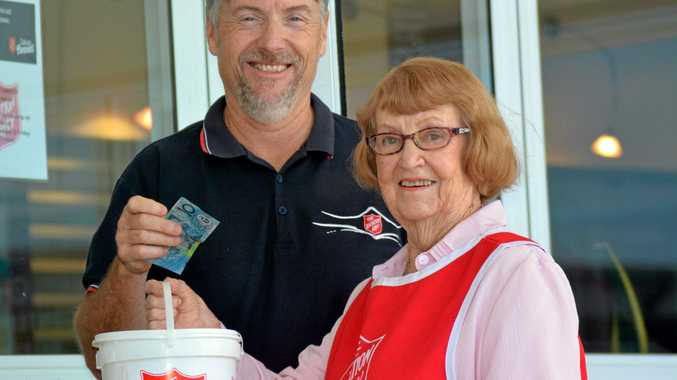 Salvation Army Major Darren Elsley demonstrates the spirit of giving to Banora Point collector Beryl Maina in the lead-up to the Red Shield Appeal Door Knock.