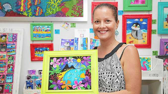 Artist Rebecca Knowles proudly shows some of her art on display at the new Harbour Gift Gallery at the Great Sandy Straits Marina, officially opened on Saturday. Photo: Jocelyn Watts / Fraser Coast Chronicle