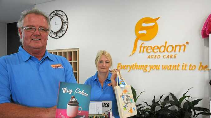 NEW OWNERS: John and Lyn Seccombe from Books and Gifts Direct deliver a fresh sample of books to Freedom Aged Care.