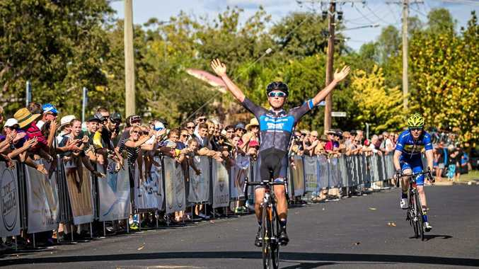 Avanti Isowhey Sports Team rider Patrick Lane crosses the finish line in Inverell after a close sprint to the line with Kenyan Riders DownUnder's Nathan Elliott.