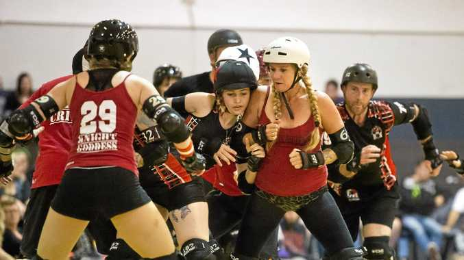 FULL CONTACT: Tina Mengel (right) from the Toowoomba City Rollers Quad Squad in action at Autumn Assault roller derby at Clive Berghofer Recreation Arena at St Mary's College, Toowoomba.