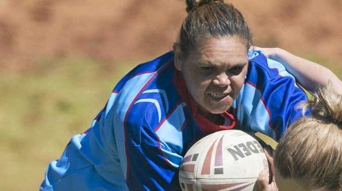 RUNNING HARD: Karen Reynolds plays for the Toowoomba Fillies.