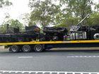 PHOTOS: 'Dingo' scrapes avocado truck off Bruce Hwy