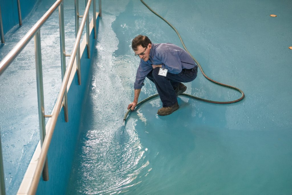 Maintenance Officer David Robertson with one of the many hoses refilling the hydrotherapy pool in South Grafton ahead of its reopening this Sunday.