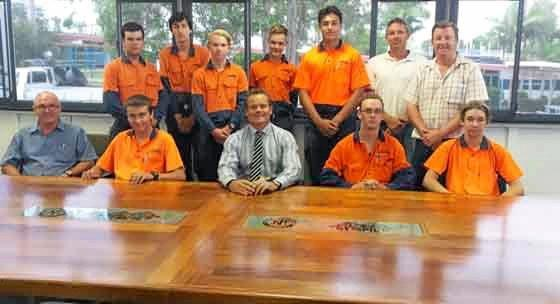 FINE FINISH: Pictured with the custom-made conference table built by Gympie Trade Training Centre for James Nash State High School are (back from left) students Jack Martin, James Barnden, Brendan Bishop, Blake Gibson, Tino Faasuamaleaui, training centre teachers Ben Stapleton and Rick Woolley, (front) training centre teacher Kerry Paige, Harrison Brunjes, James Nash principal Darrin Edwards, Michael White and Ashley Edridge. BELOW: Inlays on the table.
