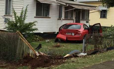 A car has crashed into a Lindsay St home in East Toowoomba.