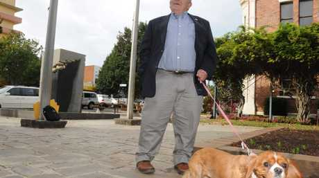 Cr Joe Ramia visits the Village Green to talk about the new dog registration tags.