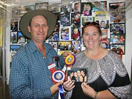 Crow's Nest Show Photography Chief Steward Stewart Burgess congratulates Darani Pyers on winning Grand Champion Photography exhibit at last weekend's show.