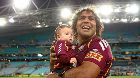 Sam Thaiday with daughter Gracie after wining the 2013 Origin series.