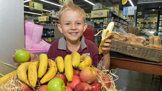 SNACK ATTACK: Donovan Bruton,6, grabs a banana while shopping with his mum at the Bli Bli IGA.