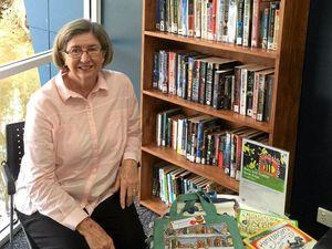 Literacy program rewards volunteer for her time