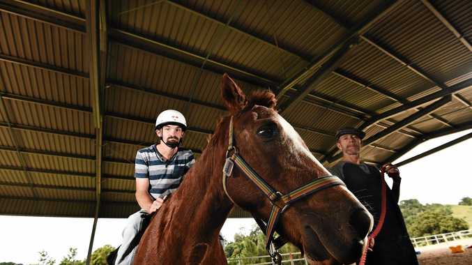 Volunteer Greg Gurney with Leon Eldridge, of Ballina, under the new all-weather enclosure at the Ballina and District Riding for the Disabled base.