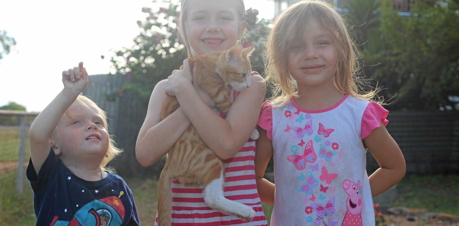 Maximilian, Maya and Melody Sandow were all happy to have their cat back.Photo Tobi Loftus / Central & North Burnett Times