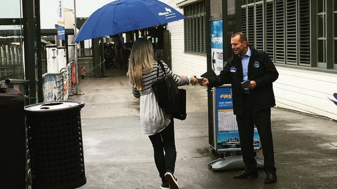 Tony Abbott handing out how to vote cards in Manly. Source: Instagram