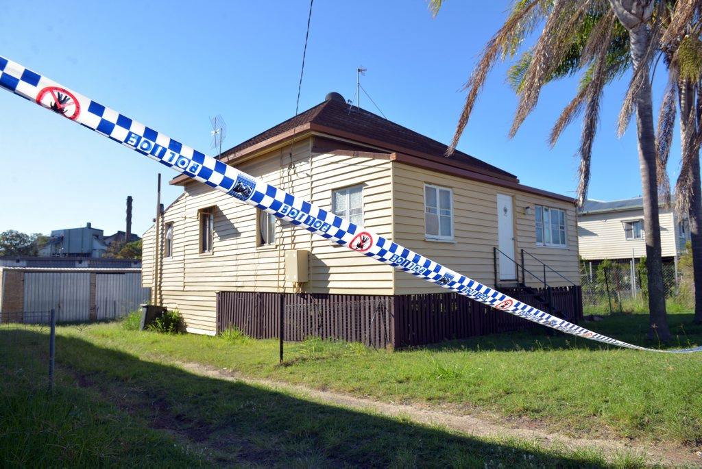 DRUG BUST: Police tape surrounds a home on Alexandra Street in East Bundaberg where police discovered a suspected drug lab. Photo: Max Fleet / NewsMail