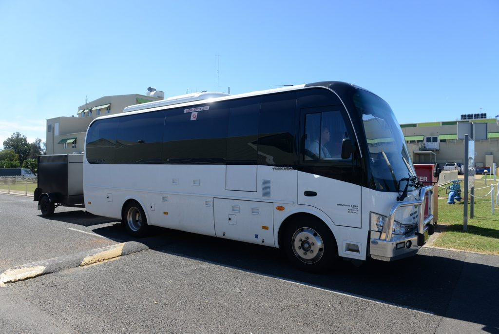 FERRY PATIENTS: The bus load of tourists leave from the Bundaberg Hospital. Photo: Mike Knott / NewsMail