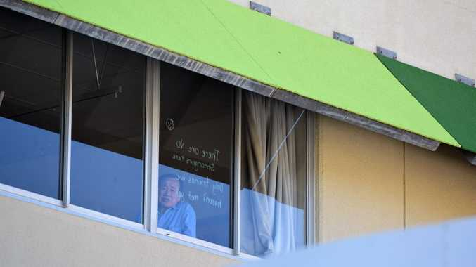 FERRY PATIENTS: Face in Bundaberg Hospital window. Photo: Craig Warhurst / NewsMail