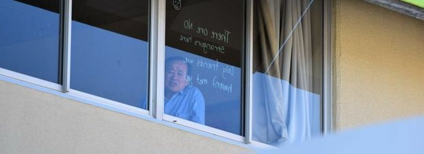 FERRY PATIENTS: Face in Bundaberg Hospital window. Photo: Craig Warhurst / NewsMail