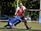 Norths winger Tetua Fetuani fends to break a tackle against the Moranbah Miners.
