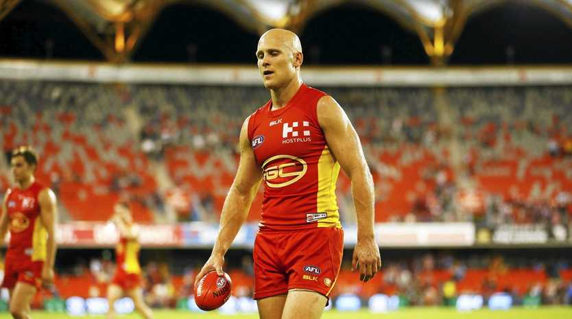 DOWN, BUT NOT OUT: Gary Ablett looks dejected as he walks from Metricon Stadium after the Suns' big loss to Melbourne.