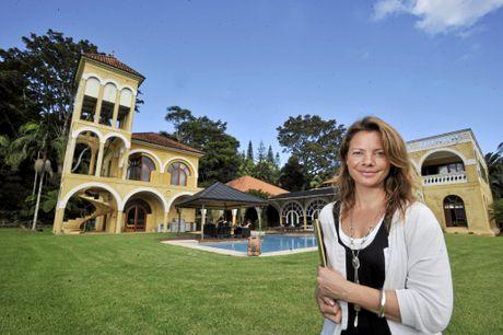 Director of Unique Estates Nicolette van Wijngaarden is pictured at Cedar Springs at Possum Creek, one of the many luxury properties she has sold.
