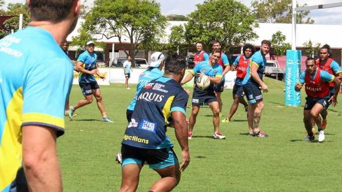 SLICK SERVICE: Toowoomba talent Nathan Friend passes the ball at Gold Coast Titans training.