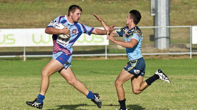 TAKING THEM ON: Clydesdales under 20s captain Todd White tries to fend off a Norths opponent earlier this season.
