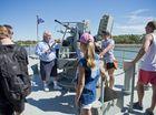 PHOTOS: Cruise passengers climb aboard HMAS Gladstone
