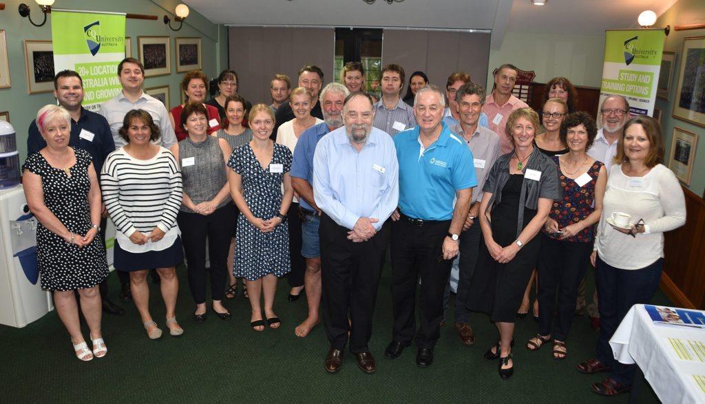 CQUni Ombudsman Dr Robert O'Sullivan (centre in light blue) with conference participants Photo Contributed