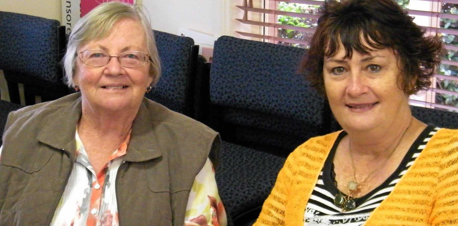 Volunteers June Burke (left) and Wendy Power enjoy the atmosphere.