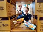 DELICIOUS TREATS: Ranger Kaitlin Allen, 15, and 1st Hervey Bay Girl Guide Kristine Still, 10, with this year's biscuits. Their patrol have about 4000 packs to sell this Saturday.