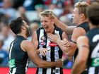 GOAL REACHED: Josh Smith celebrates his first goal on debut with teammates at the MCG.