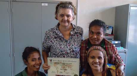 CHANGING LIVES: Former Toowoomba woman Mary Deakin (second right) with three staff members from The National Centre of Employment and Professional Training (CNEFP) in Tibar, Timor-Leste.
