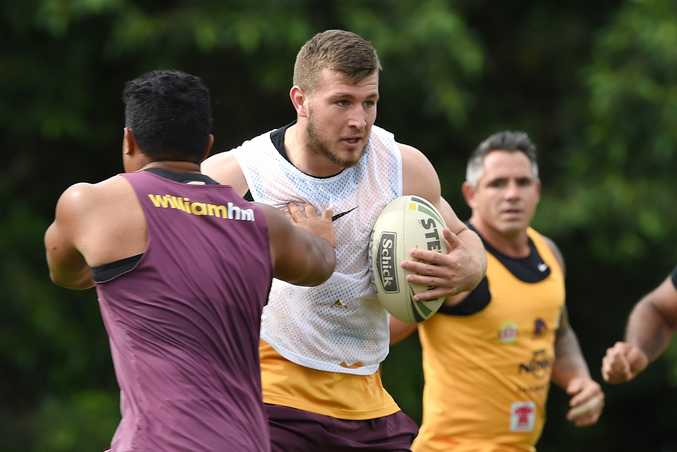 Jai Arrow (centre)  during a Brisbane Broncos training session at Red Hill this week. Photo: AAP Image/Dave Hunt.