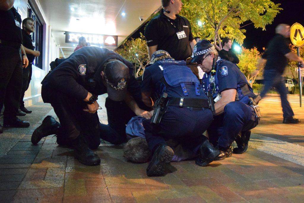 OPERATION JABBAH: Police restrain a man on Bourbong St earlier this month.