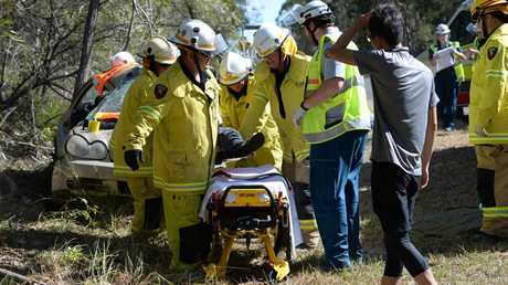 Emergency crews work to free trapped woman after car crash Photo: Mike Knott / NewsMail
