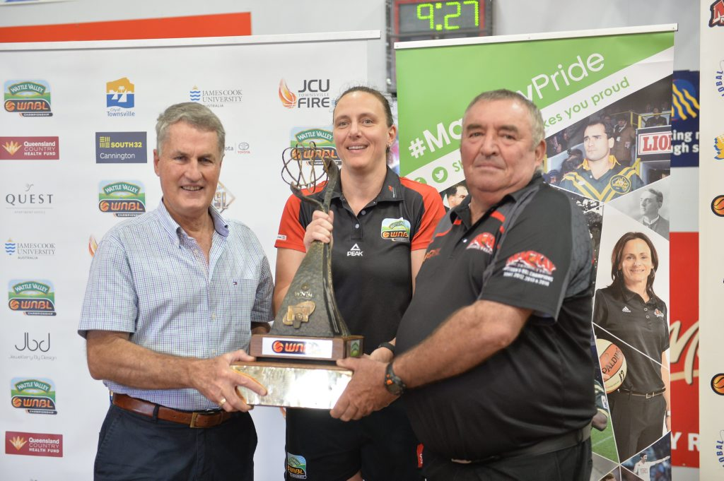 Mackay Mayor Greg Williamson, Townsville Fire coach Claudia Brassard and Mackay Basketball president John Zelenka with the WNBL trophy. A pre-season WNBL game will be held here in September.