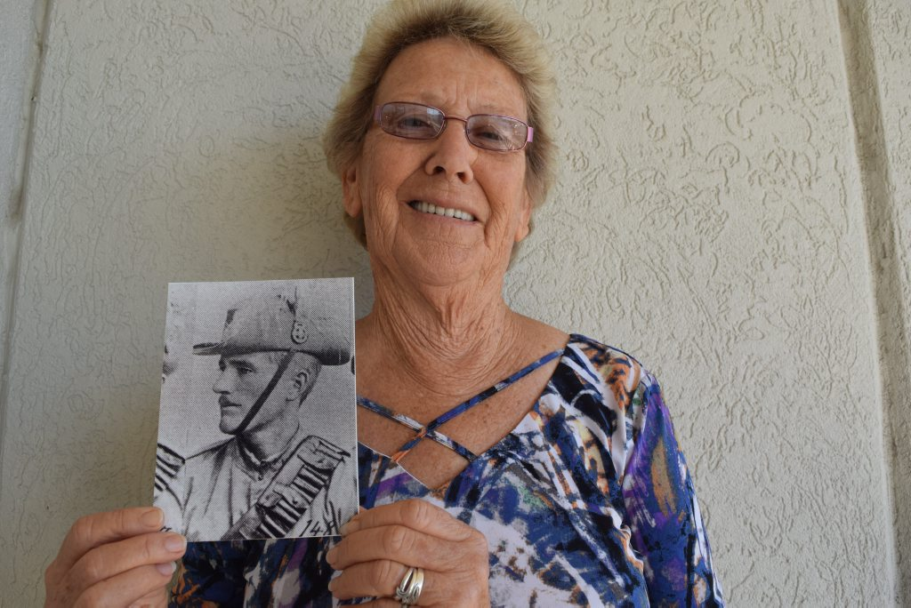 """Image for sale: """"I THOUGHT THEY'D NEVER FIND HIM"""": Maxine Hebbard with a photo of her great uncle, James Benson, aged 20. Photo: Eliza Goetze / NewsMail"""