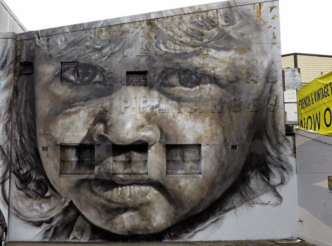STREET ART: An example of one of Guido van Helten's works at Redfern.