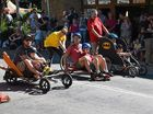 TOP GEAR: Eventual heat winners Warwick and Aquila Porter (blue helmets) Cline up in a parent and child race during the annual Bangalow Billycart Derby yesterday.