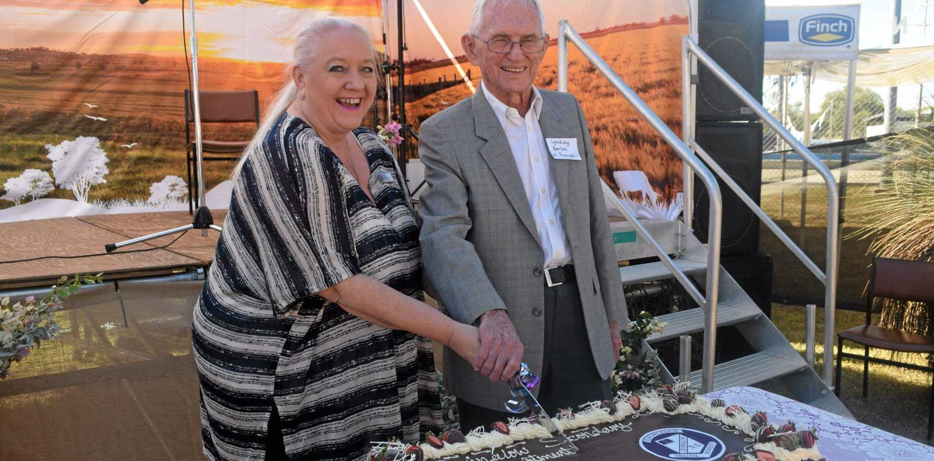 50 YEARS: Current principal Susan Booth and first principal Lyndsay Barton cut the cake at Quinalow's school celebrations.