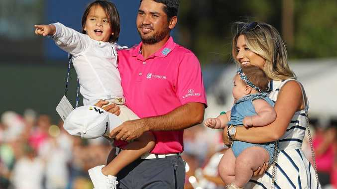 WHAT A DAY: Jason Day celebrates his Players Championship win with son Dash, wife Ellie and daughter Lucy.