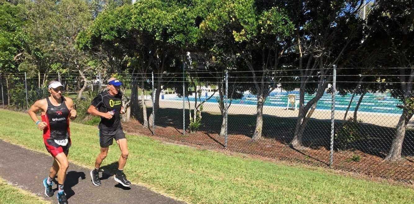 Tim Franklin (left) running through Coolum with Tony Bryan.