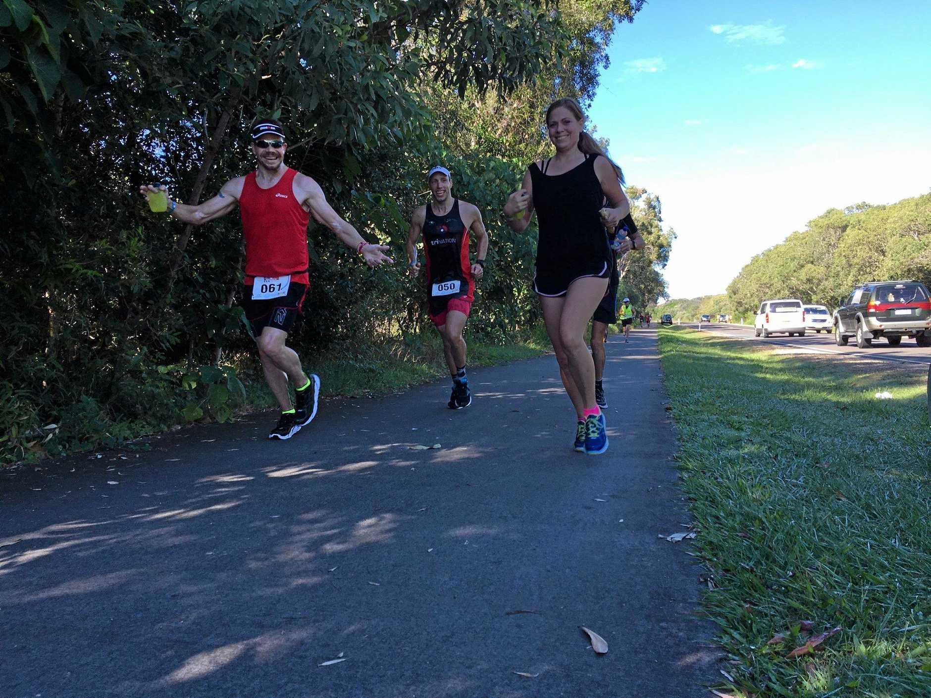 Paul McDonald all smiles on the run (left) and Tim Franklin run through Mudjimba.