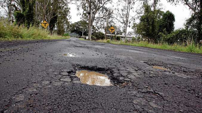 File photo of potholes along Tatham Rd near the intersection of the Bruxner Hwy, between Lismore and Casino.
