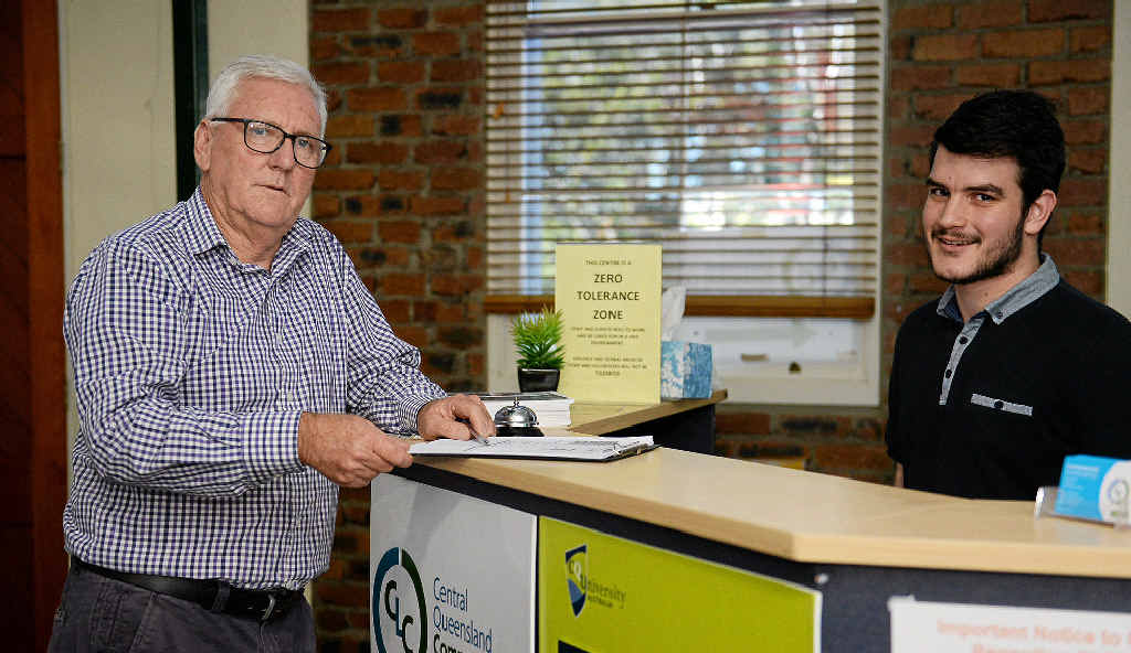 KEY ADVICE: Wayne Jones speaks to student Joshua Morgan about his fears the region's only community legal service will have to cut services for local residents if the federal government's funding cuts go ahead.